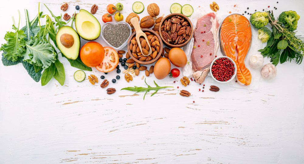 healthy foods selection on white wooden background